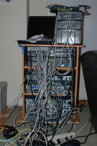 The author's 2008 CCIE security lab. The laptop ran Windows Server in a VM for ACS. An ASA 5505 is visible on top of the drawers.